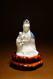 Ancient Quan Yin - Buddhist Goddess of mercy. Ceramic statue Stock Image