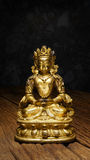 Ancient Quan Yin - Buddhist Goddess of mercy. Gold statue Stock Photography