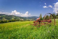 Ancient rake in a field Stock Photo