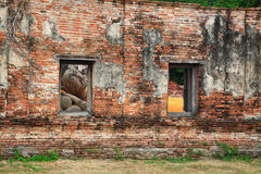 Ancient Reclining buddha through windows at Ayutthaya Royalty Free Stock Images