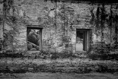 Ancient Reclining buddha through windows at Ayutthaya Stock Images