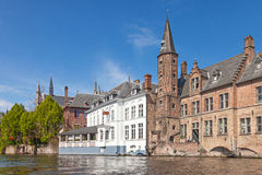 Ancient red brick building with little tower in Bruges Stock Photography