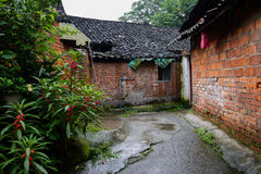 Ancient red-brick dwelling houses in alley after rain Royalty Free Stock Photos