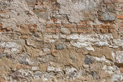 Ancient red brick wall with remaining plaster spot Royalty Free Stock Photo