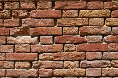 Ancient red brick wall texture background, sunlight. Ancient red brick wall texture background in Italy, sunlight royalty free stock photography