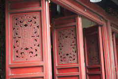 Ancient red door. Hanoi, Vietnam. Red wooden door in an ancient temple in Hanoi, Vietnam royalty free stock photo