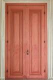 Ancient Red Door. With white door frame Stock Photos