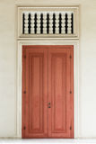 Ancient Red Door. With white door frame and air passage Stock Images