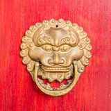 Ancient red doors with gilded studs and lion head door knockers Royalty Free Stock Photos