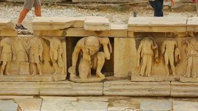 Ancient relief with antique mythological creatures at Theater of Dionysus ruins. Stock footage stock video footage