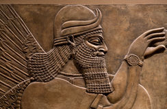 Ancient relief of an assyrian god.  Royalty Free Stock Image