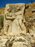Ancient relief: Hercules shakes hands with King Antiochus Royalty Free Stock Photo