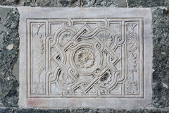 Ancient relief of plants and flowers. Byzantine relief of two griffin outside Saint Mark Basilica in Venice Stock Photos