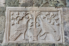 Ancient relief of two peacocks. Byzantine relief of two peacocks outside Saint Mark Basilica in Venice Stock Photo
