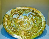 The ancient restored plate with beautiful paintings, Tehran, Ira. TEHRAN, IRAN - OCTOBER 24, 2017: Ancient restored plate with beautiful patterns and paintings Royalty Free Stock Photos