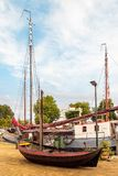 Ancient restored sailing boat in the Dutch harbor of Gouda Stock Photography