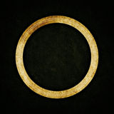 Ancient ring on abstract texture background. Ancient golden ring on abstract texture background royalty free stock image