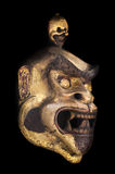 Ancient ritual wooden mask. On a dark background Royalty Free Stock Photos