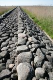 Ancient road. Ancient roman cobblestone road through the field Royalty Free Stock Images