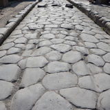 Ancient road with original ruts in the stone, Pompeii Royalty Free Stock Images