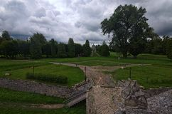 Ancient road through the park to the Church of Exaltation of the Holy and St. Joseph. View from terrace of Pidhirtsi Castle. royalty free stock photos