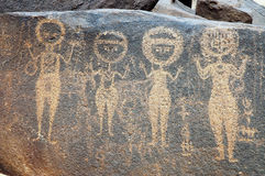 Ancient rock art in Niger depicting four figures Royalty Free Stock Photos