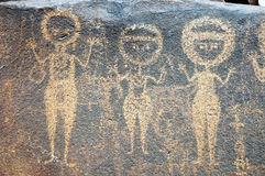 Ancient rock art in Niger depicting three figures Stock Photography