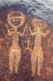 Ancient rock art in Niger of two human figures Royalty Free Stock Image