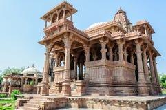 Ancient rock curved temples of Hindu Gods and goddess. At Mandore garden, Jodhpur, Rajasthan, India Stock Photography