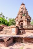 Ancient rock curved temples of Hindu Gods and godess Stock Photography