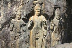 Ancient Rock-Cut Buddhist Figures of Sri Lanka Royalty Free Stock Photo