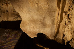 Ancient rock drawing in Tham Lot cave Stock Image