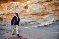 Ancient rock drawings in Somalia. A policeman on the protection of the historical places of Las Gil Royalty Free Stock Photo