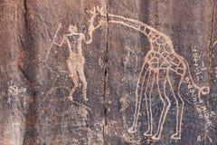 Ancient rock engraving in Sahara Desert Royalty Free Stock Image