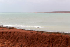 Ancient rock formations at James Price Point, Broome, North Western Australia on a cloudy summer day. Stock Photography