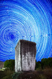 Ancient Rock n the background startrails stock photos