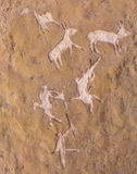 Ancient rock paintings. On natural stone closeup Royalty Free Stock Image