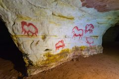 Ancient rock paintings on the wall in the grotto stock photo