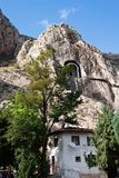 Ancient rock tombs in the Turkish city of Amasya, Turkey, Asia. Ancient rock tombs and new hous in the Turkish city of Amasya, Turkey, Asia stock photography