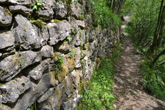 Ancient rock wall and mountain path near Resegone  Stock Photography