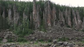 Ancient rocks. In the depths of the taiga ancient rocks hiding behind the trees stock footage