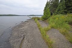 Ancient Rocks on a Wilderness Lake Shore. On Tuscarora Lake in the Boundary Waters in Minnesota Stock Photography