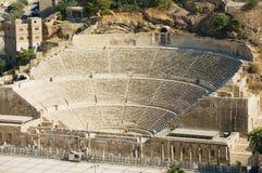 Ancient Roman amphitheater in Amman, Jordan. AMMAN, JORDAN - AUGUST 18, 2012: View to the ancient Roman amphitheater in Amman, Jordan Stock Photo