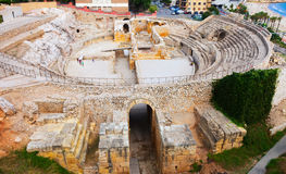 Ancient Roman amphitheater at Mediterranean Royalty Free Stock Images