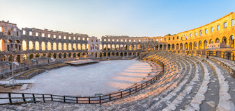 Ancient Roman Amphitheater in Pula, Croatia. Inside of Ancient Roman Amphitheater in Pula, Croatia, Famous Travel Destination, in Sunny Summer Evening Stock Photo