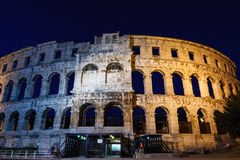 Ancient Roman Amphitheater in Pula at Night Stock Image