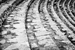 Ancient Roman Amphitheatre rows. Amphitheatre rows, seats stairway closeup. Ancient Roman theatre, Pula, Croatia. Black and white monochrome texture Stock Images