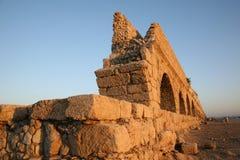 Ancient Roman aqueduct. At Caesaria, in Israel Stock Photo