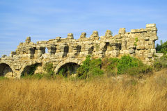 Ancient roman aqueduct. Ruins of ancient roman aqueduct in Side, Turkey Royalty Free Stock Images