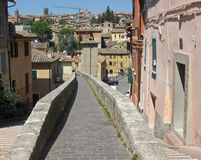 Ancient Roman aqueduct became a sidewalk in the town of Perugia Royalty Free Stock Photo